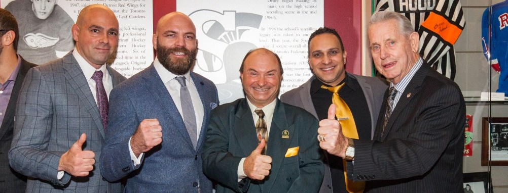 Milton Mayor and Sports Hall of Fame inductees celebrating with a thumbs up.