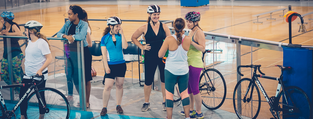 group of women on the velodrome track