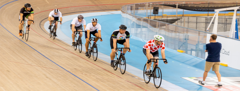 group of adults riding on the cycling track