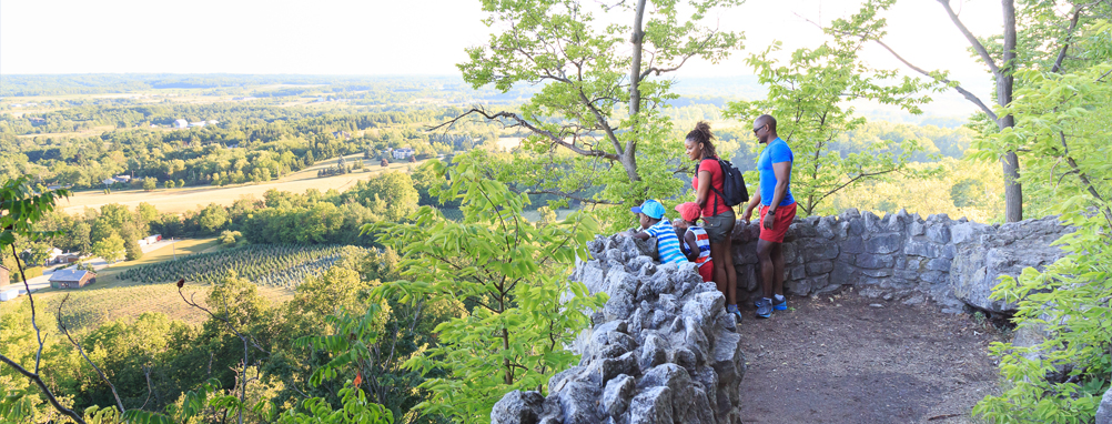 a family looking out over the Niagara Escarpment at Milton