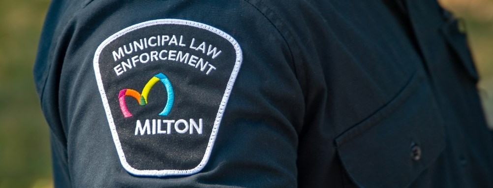 A Milton bylaw officers arm patch of his uniform.