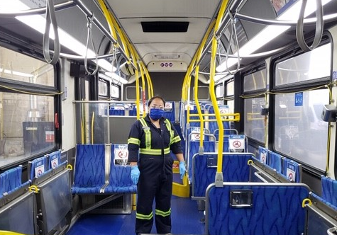 Woman cleaning inside of bus