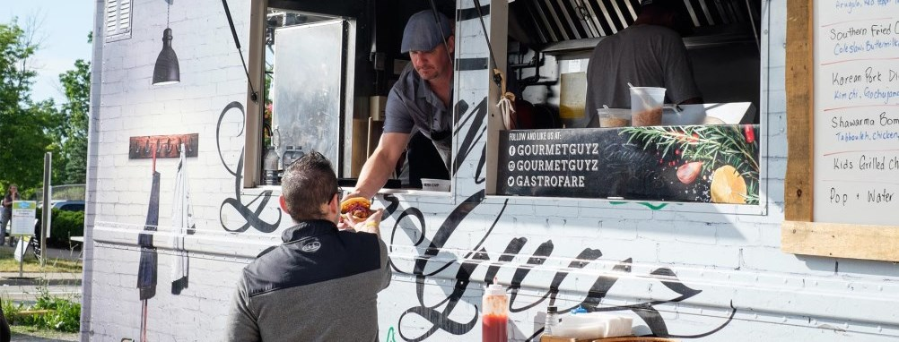 Man serving food from a food truck